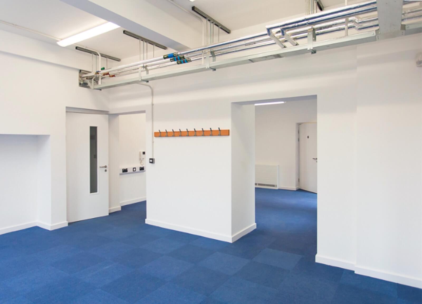 Steiner Academy hallway white fire door